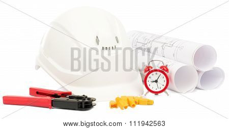 Blueprint rols and helmet with tools