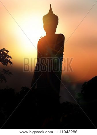 Silhouette In Buddha  On The Sunset Background