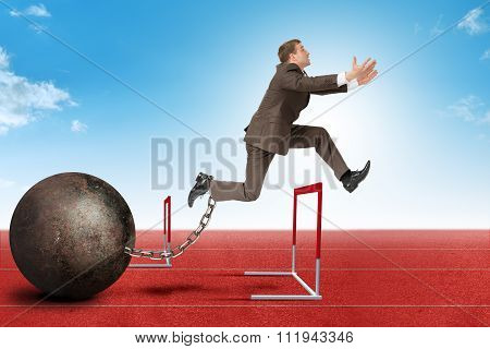 Businessman jumping over barrier