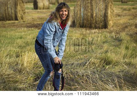 Surprised Woman Holding a Camera