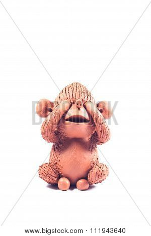 Close-up Monkey Clay Doll Isolated On White Background