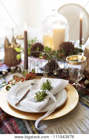 Elegant and Warm Christmas Table Setting with candles and gold