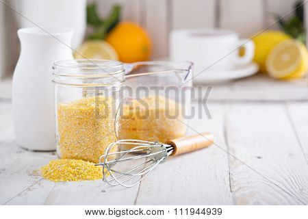 Raw cornmeal with a whisk