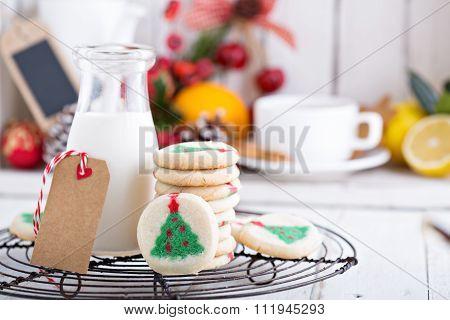 Christmas tree cookies with milk