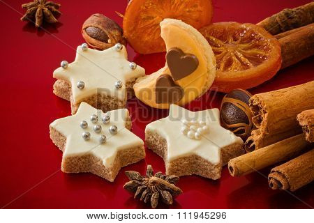 Christmas Cookies, In Different Shapes, With Spices, Festive Red Background