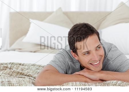 Cheerful Man Lying In His Bedroom