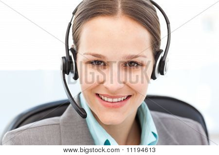 Portrait Of A Friendly Operator With Earpiece