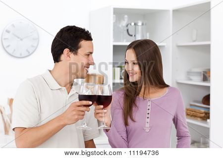 Lovely Couple Giving A Toast With Red Wine