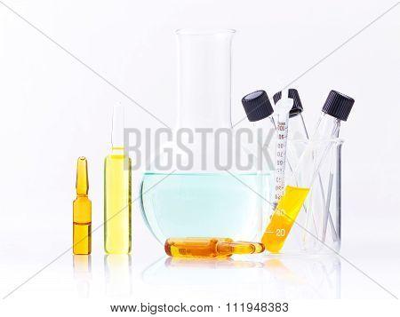 Medical Ampoules And Syringe Isolated On White Background