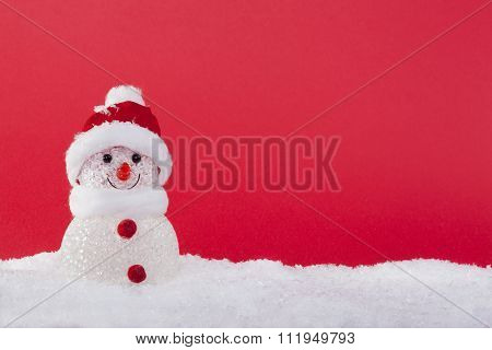 snowman in the snow with Christmas balls