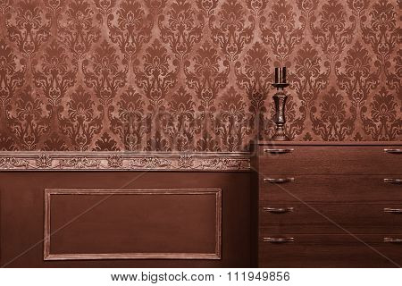 Candle On Furniture In Vintage Room With Rococo Pattern Background