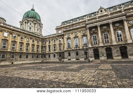 Budapest, Hungary - December 10, 2015: People Visit Buda Castle In Budapest. It Is The Largest City
