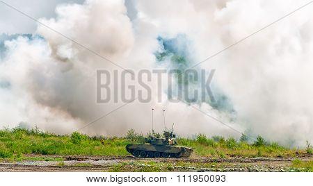 Russian tank T-80 making smoke screen from enemy