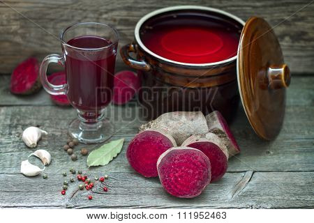 Pickled beetroots and homemade juice on vintage boards