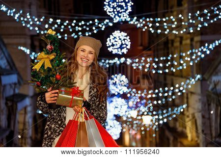 Woman With Christmas Tree, Gift And Shopping Bags In Venice