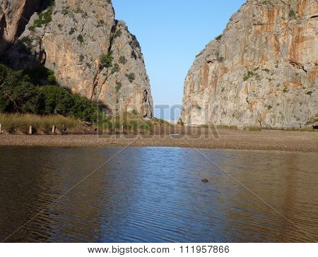 Rock Formation Reflected In The Water In Sa Calobra Canyon