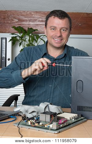 Happy Engineer Proceeding To Data Recovery From Computer