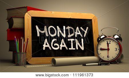 Monday Again Handwritten on a Blackboard.