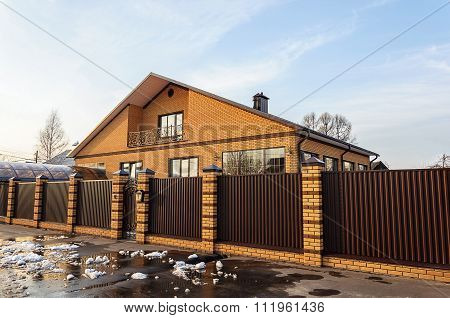 Beautiful Contemporary Brick House Behind A Metal Fence