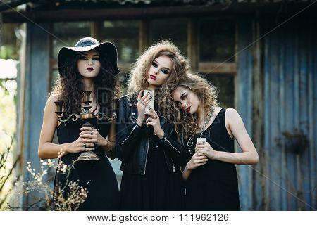 three vintage women as witches