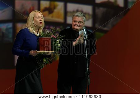 ST. PETERSBURG, RUSSIA - DECEMBER 16, 2015: Artistic Director of Petersburg-concert Sergey Stadler (center) during the closing ceremony of 4th St. Petersburg International Cultural Forum