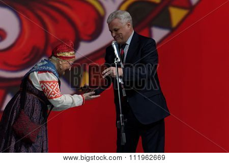 ST. PETERSBURG, RUSSIA - DECEMBER 16, 2015: Rector of Saint-Petersburg State University of Culture and Arts Alexander Turgayev (center) presenting awards during the closing ceremony of Cultural Forum
