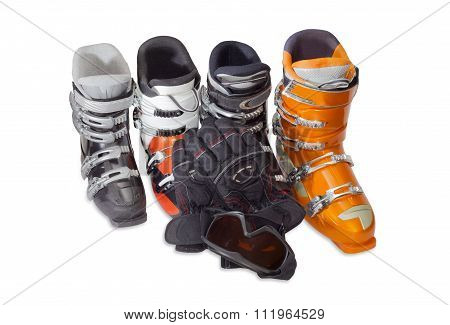 Several Alpine Ski Boots, Ski Goggles And Ski Glove