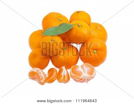 Pile Of Mandarin Oranges And Several Segments Of Peeled Mandarine