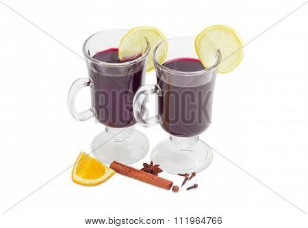 Two Mugs With Mulled Wine And Slices Of Lemon