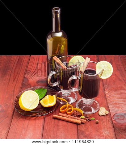 Two Mugs With Mulled Wine, Bottle Of Wine, Mulling Spices