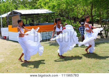 ILE AUX CERFS, MAURITIUS ISLAND - OCTOBER 31, 2015 : Creole women dancing traditional Sega dance. It  is one of the major music genres of Mauritius. Music originated among the slave populations.