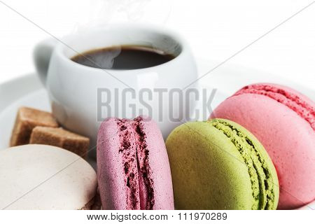 Cup Of Coffee And Macaroons On White