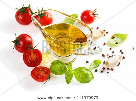 Olive Oil With Fresh Basil Leaves And Tomatoes