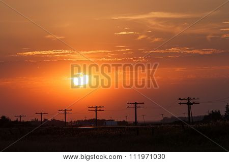 Silhouetted Power Lines At Golden Sunset