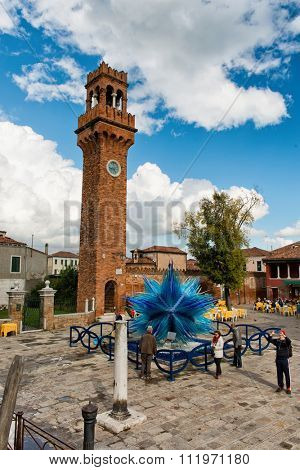 VENICE, ITALY - 17 OCTOBER 2015: Glass artwork of blue star and clock tower on Murano island. Venice, Italy on 17 October 2015.