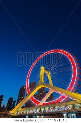 Night Scene Cityscape Of Tianjin Ferris Wheel,tianjin Eye With Dark Blue Background. Tianjin Eye Is