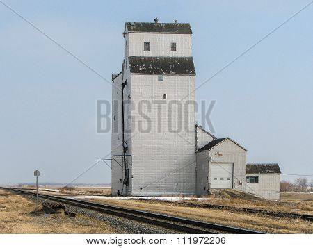 Grain Elevator By Track In Prairie