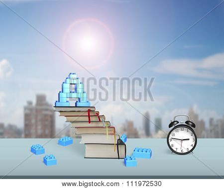 Letter A Shape Blocks On Books Stairs With Alarm Clock