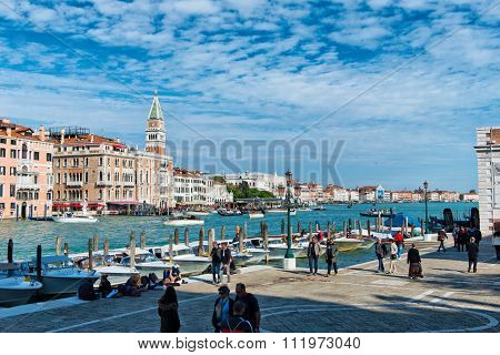 VENICE, ITALY - 17 OCTOBER 2015: View at Fondamenta Salute towards Campanile and St Mark Square. Venice, Italy on 17 October 2015.