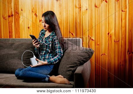 Girl With Powerbank Charging Smartphone