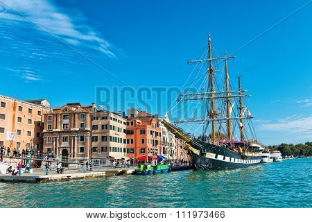VENICE, ITALY - 17 OCTOBER 2015:Italian Navy historic training barquentine, the Palinuro, moored on the riva in Venice, Italy in the Giudecca Canal. Venice, Italy on 17 October 2015.