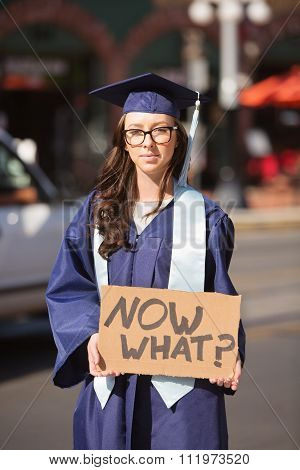 College Graduate Standing With Sign
