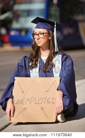 Serious Graduate With Unemployed Sign