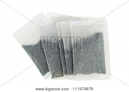 Porous bags with powdered tea leaves inside,  isolated on white background
