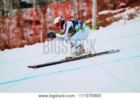 downhill racer young men in competition Russian Cup in alpine skiing