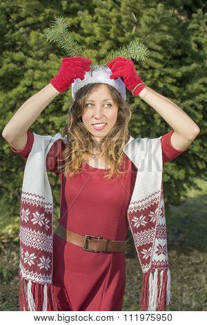 Beautiful Santa Claus Girl With A Fir Tree Branch
