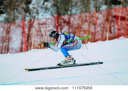 downhill from mountain man racer on skis during Russian Cup in alpine skiing