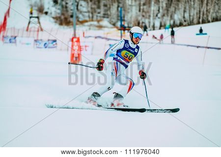 young man skier after finish spray of snow during Russian Cup in alpine skiing