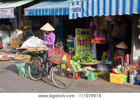 Vietnamese women in traditional conical hat at the wet market of Nha Trang, Vietnam