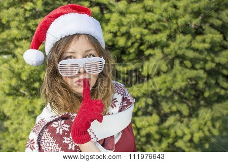 Beautiful Santa Claus Girl With Finger On Her Lips